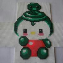 Hello Kitty déguisée en vert