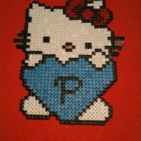 Hello Kitty et son coeur bleu