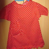 Robe enfant - rouge à pois blancs.